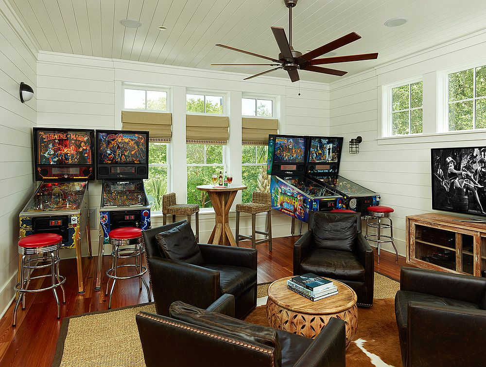 Tropical family room with a collection of pinball machines
