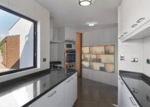 Unique-contemporary-kitchen-in-white-217x155