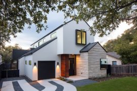 Multiple Gable Roofs and Dark Accents Shape an Exceptional Street Façade