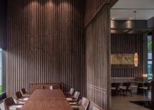 Vertical-wooden-slats-bring-the-image-of-forest-indoors-217x155