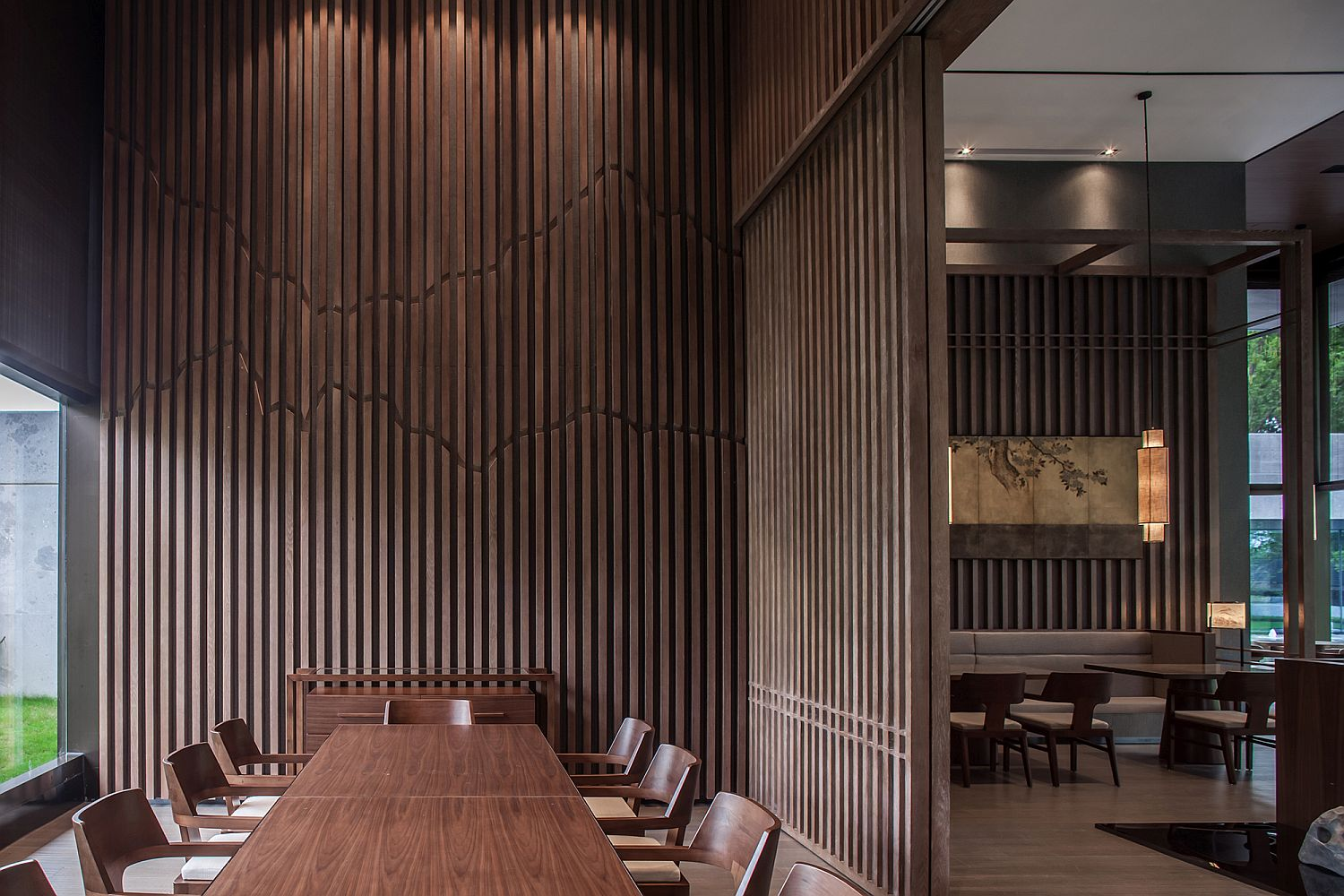 Vertical wooden slats bring the image of forest indoors