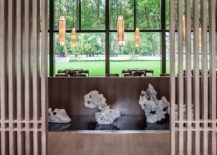 Wall-of-glass-connects-the-interior-with-the-lush-green-outdoors-217x155
