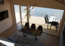 Wooden-deck-of-the-cabin-seemsto-float-above-water-217x155