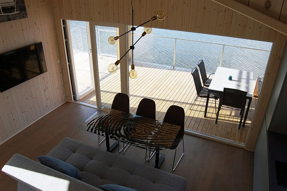 Wooden deck of the cabin seems to float above water