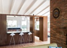 Wooden-walls-delineate-the-living-area-from-the-kitchen-217x155