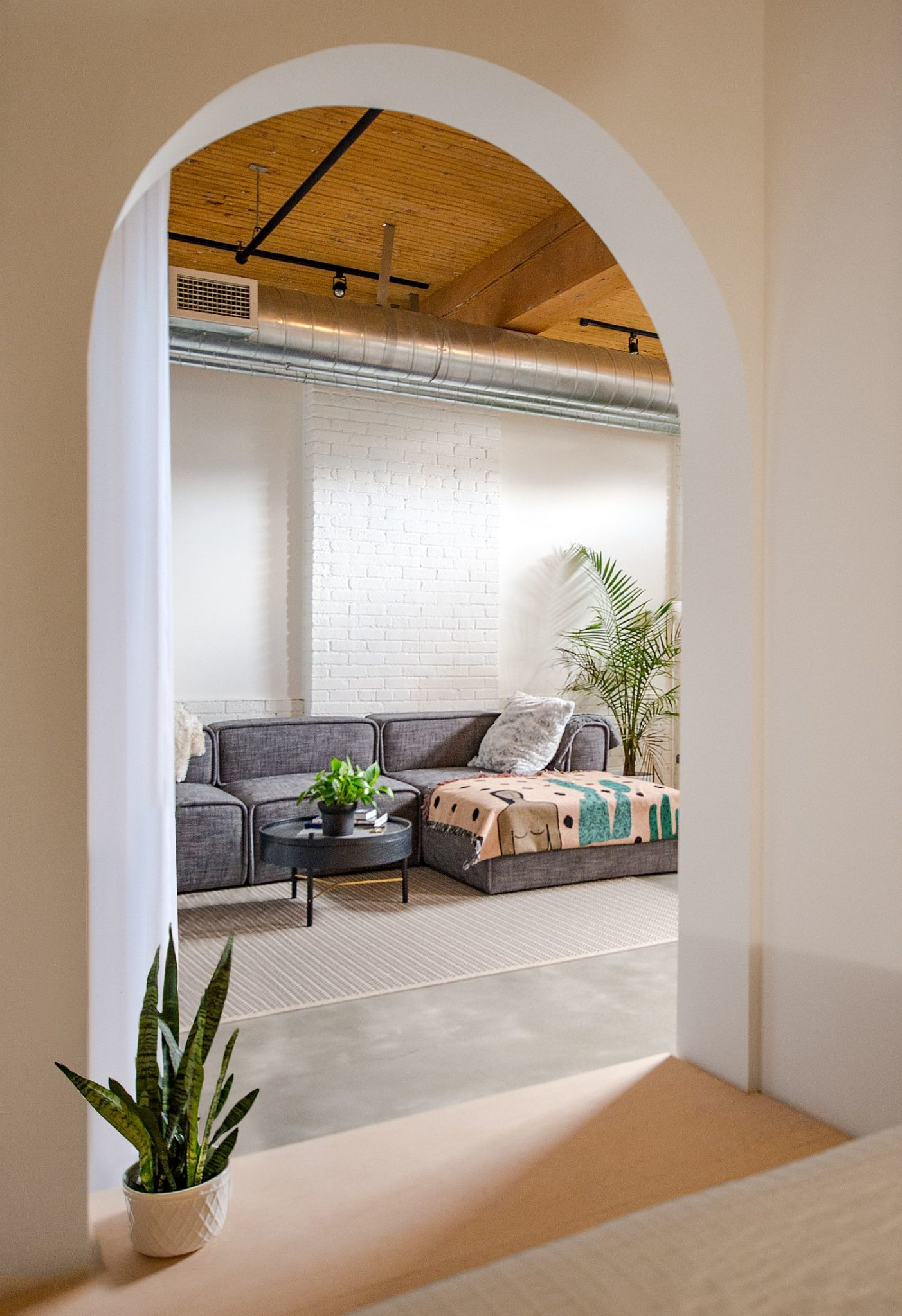 Arched doorways and entryways give the loft a unique look