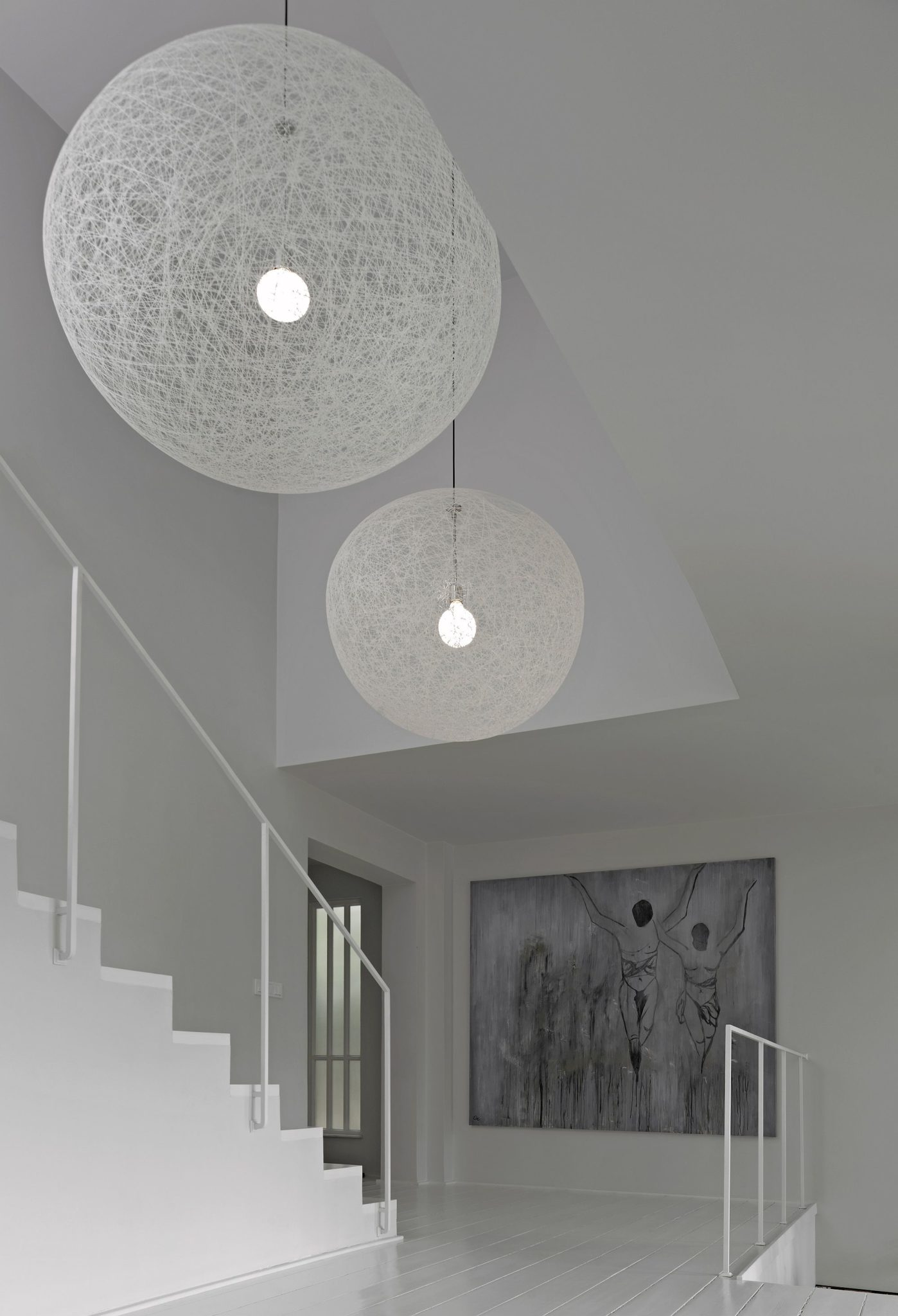 Beautiful Moooi pendants steal the show inside the home even while blending into the backdrop