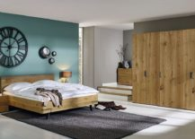 Bed-nightstand-console-and-wardrobe-in-oak-create-a-relaxing-and-modern-bedroom-217x155