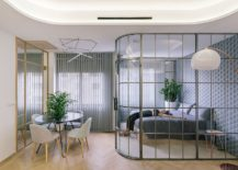 Bedroom-separated-from-the-living-room-using-curved-glass-wall-217x155