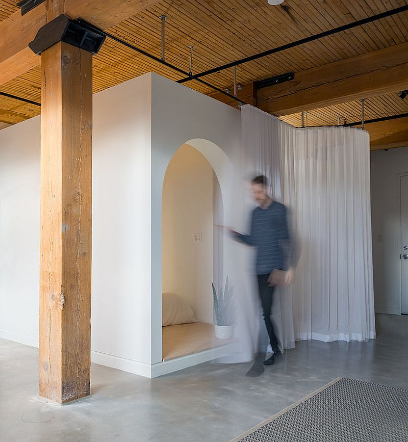 Box-style-bedroom-with-long-white-curtains-provides-space-savvy-solution