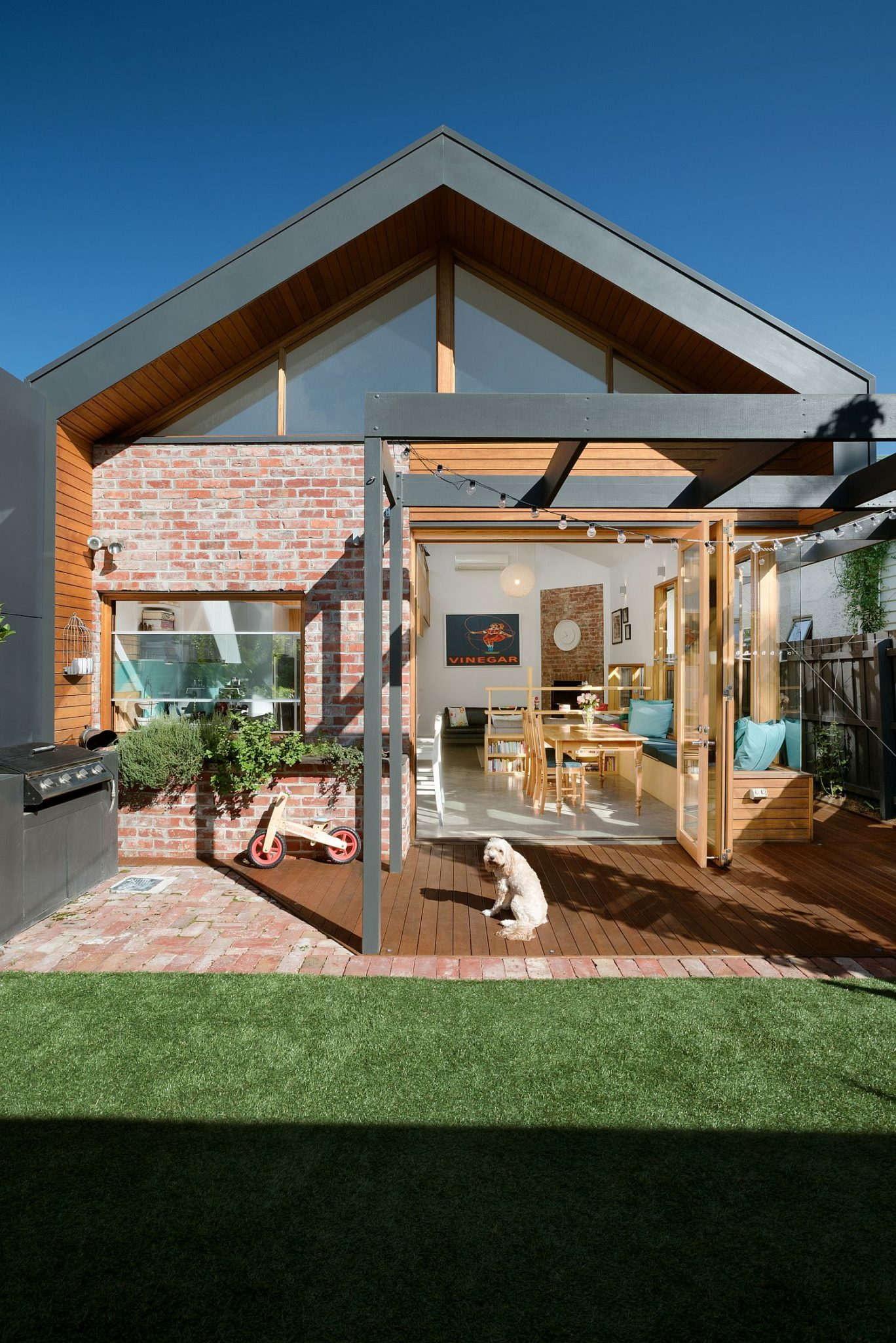 Brick, wood and gray create a unique extension for the Victorian cottage in Melbourne