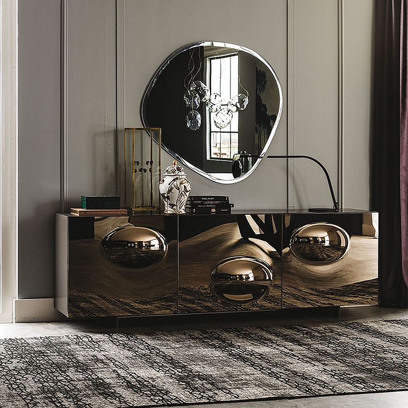 Bronze convex mirrored glass creates a cool sideboard with plenty of glint