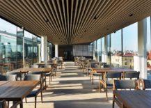 Carfeully-spaced-oak-strips-create-a-unique-restaurant-ceiling-217x155