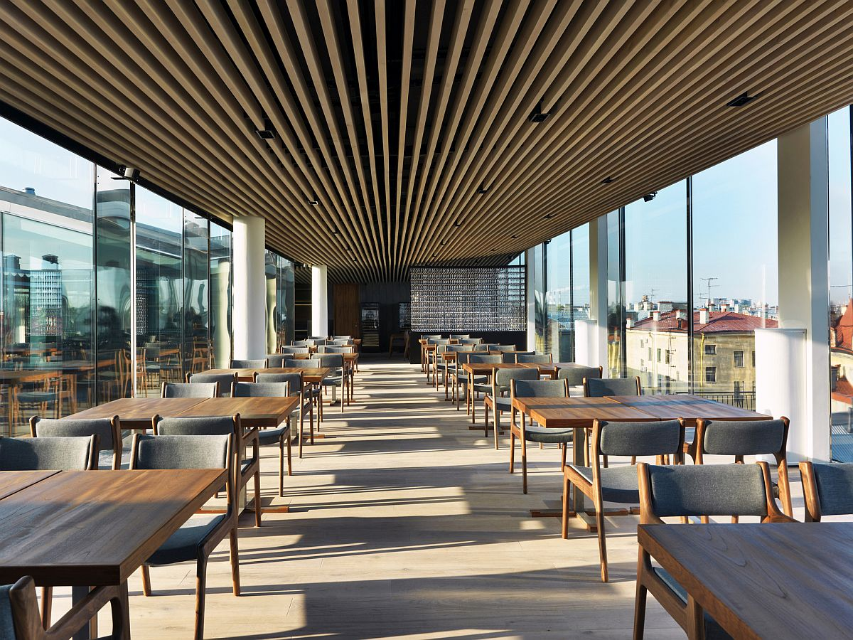 Carefully spaced oak strips create a unique restaurant ceiling