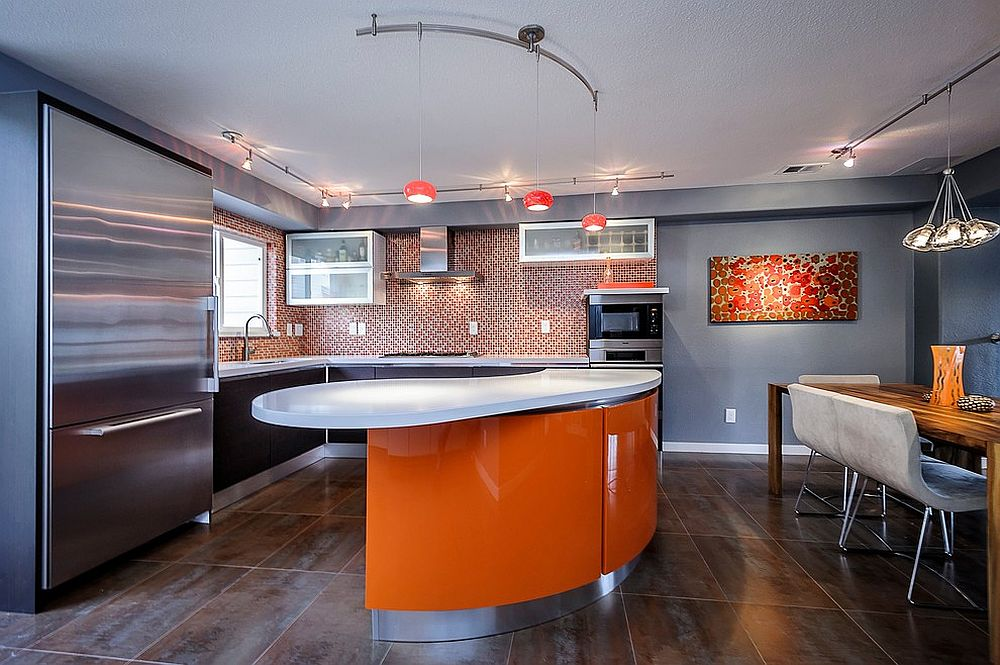 Contemporary kitchen with an orange island and matching pendants