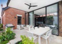 Covered-alfresco-dining-and-sitting-area-that-flows-into-the-backyard-217x155