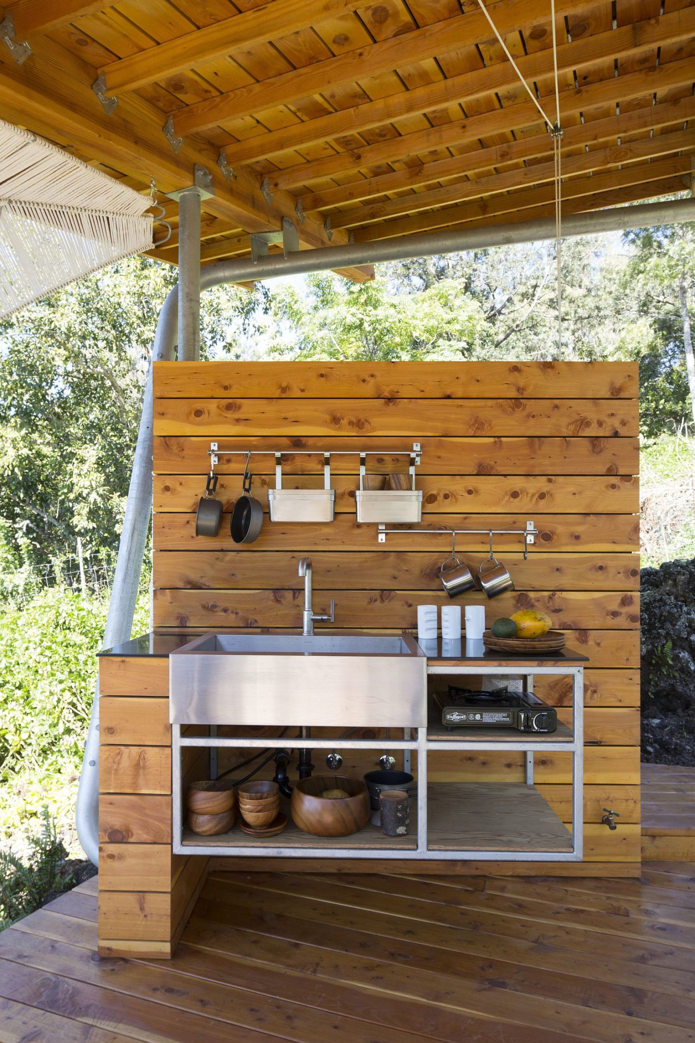 Covered-pavilion-with-outdoor-kitchen-creates-a-connect-with-the-landscape