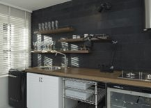 Dark-accent-wall-offers-the-perfect-backdrop-for-the-kitchenette-217x155