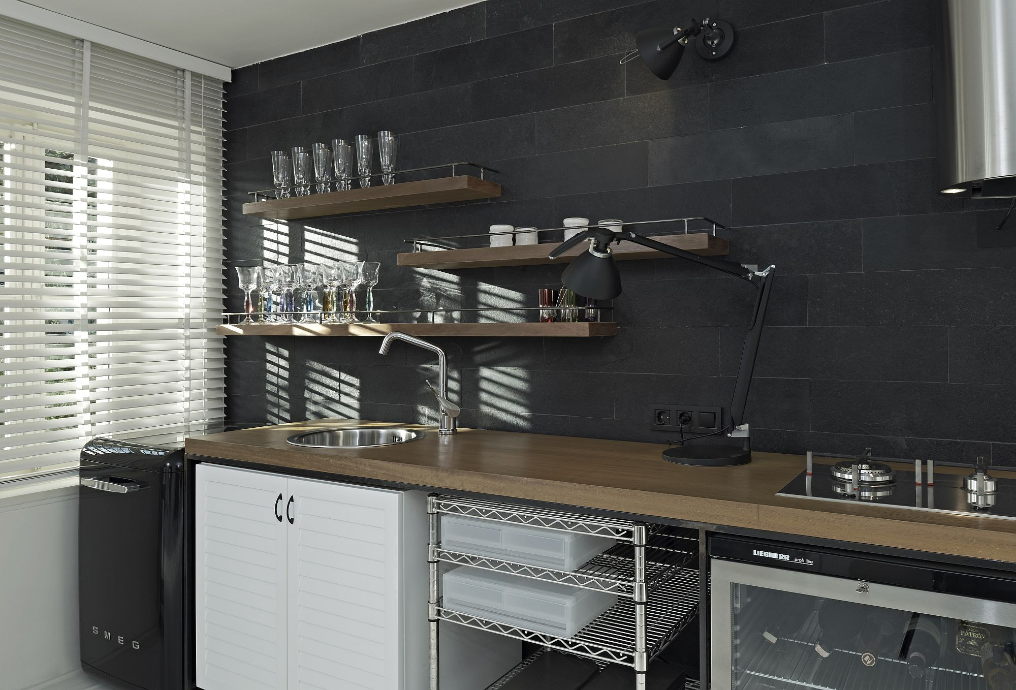 Dark accent wall offers the perfect backdrop for the kitchenette
