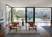Dark-framed-glass-doors-connect-the-livig-area-with-the-outdoor-dining-and-backyard-217x155