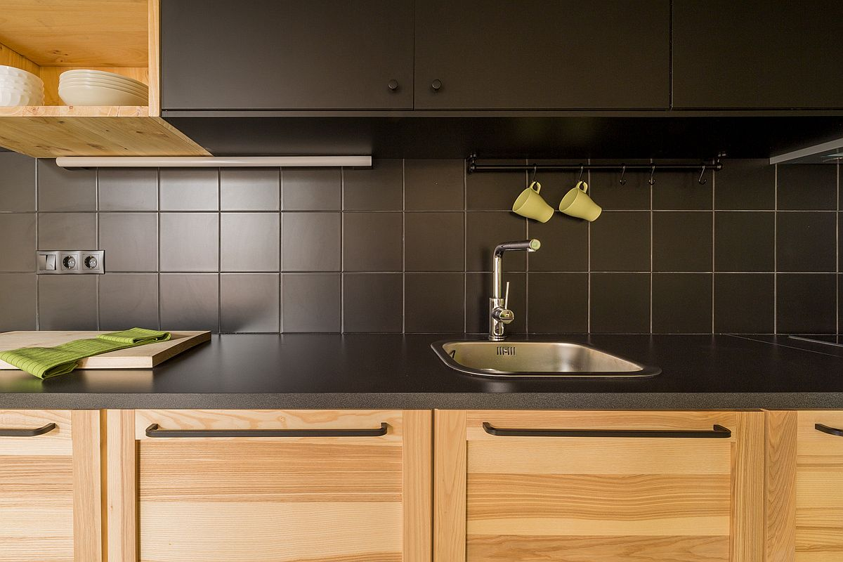 Dark kitchen cabinets and counters coupled with lighter wood tones