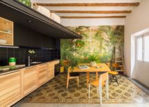 Dining-area-and-kitchen-with-a-vibrant-and-colorful-backdrop-217x155