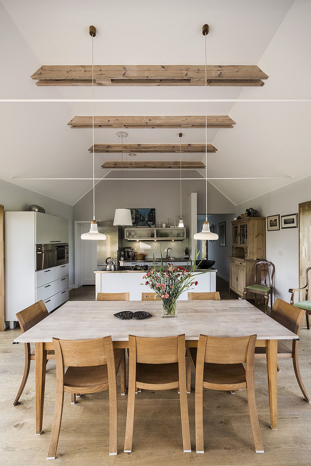 Dining area, kitchen and open living space of the Polish home