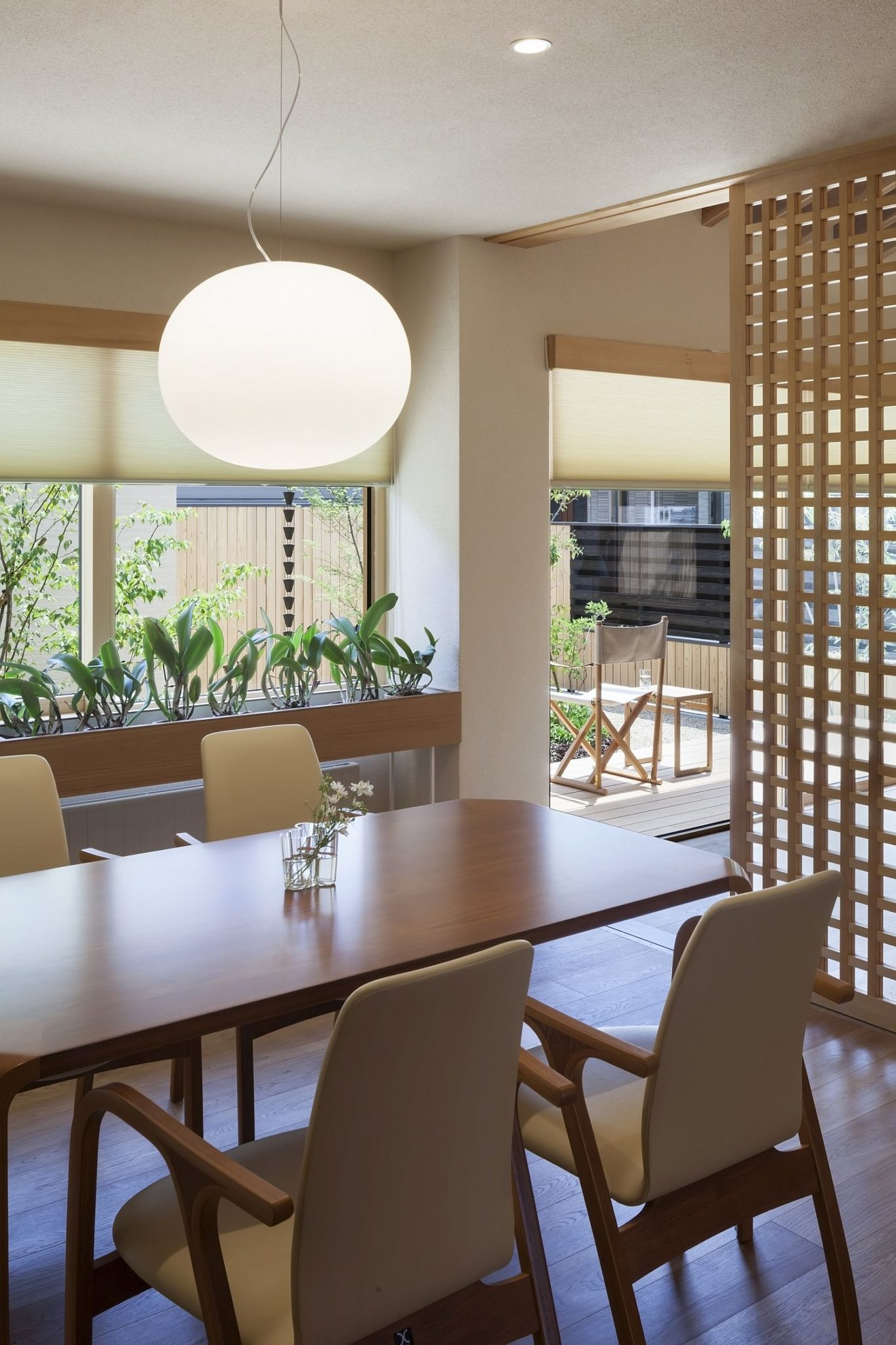 Dining area with smart pendant lighting and a cool divider