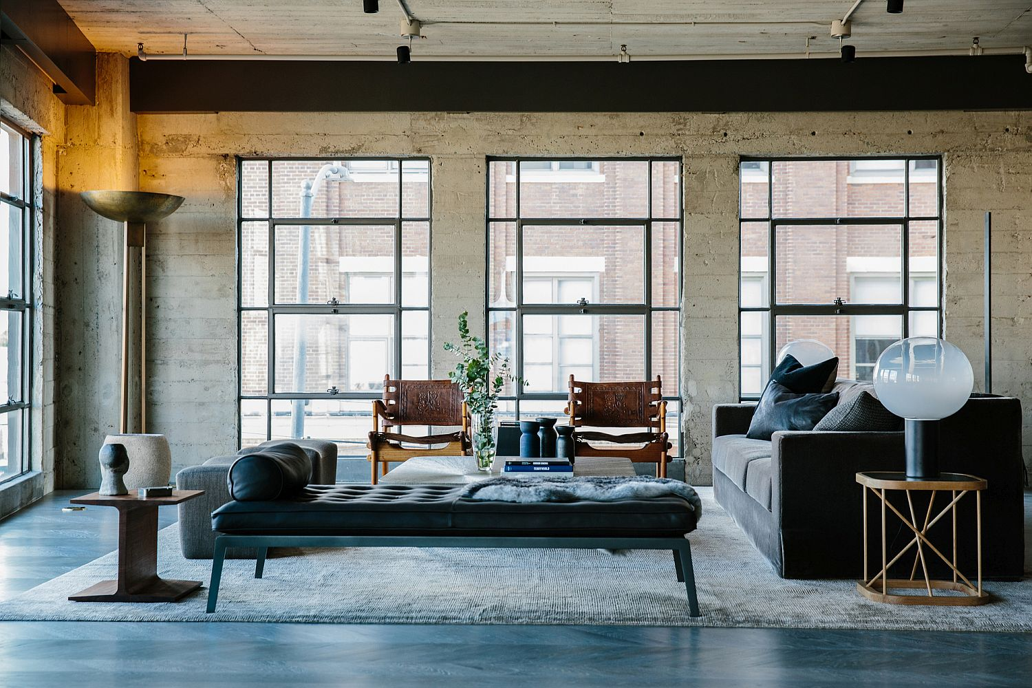 Exposed-concrete-walls-and-a-polished-floor-blend-in-beautifully-with-the-industrial-vibe-of-the-home