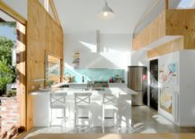 Fabulous-corner-kitchen-in-white-with-bright-blue-backsplash-217x155