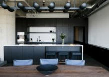 Fabulous-kitchen-in-black-with-stunning-lighting-and-an-island-in-bluish-gray-217x155