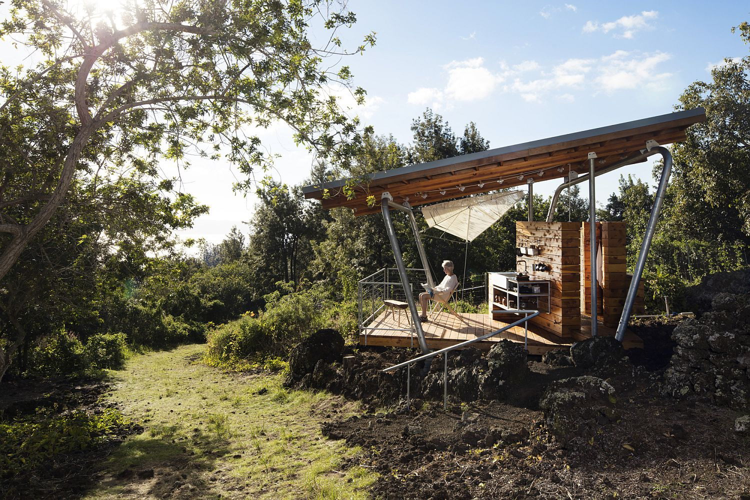 Fabulous pavilion style outdoor house sits above the 300-year old lava flow