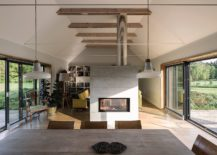 Fireplace-delineates-the-living-room-from-the-kitchen-and-dining-217x155