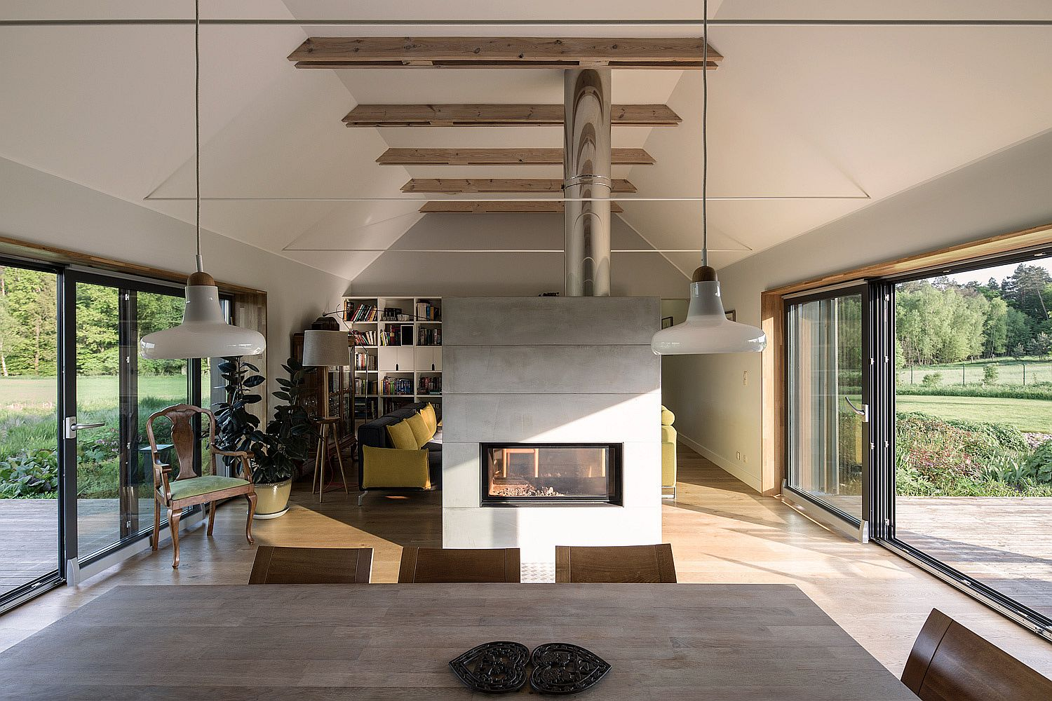 Fireplace delineates the living room from the kitchen and dining
