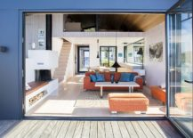 Folding-glass-doors-open-up-the-living-area-to-the-deck-outside-217x155