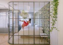 Framed-glass-walls-create-visual-connection-even-as-drapes-offer-privacy-when-needed-217x155