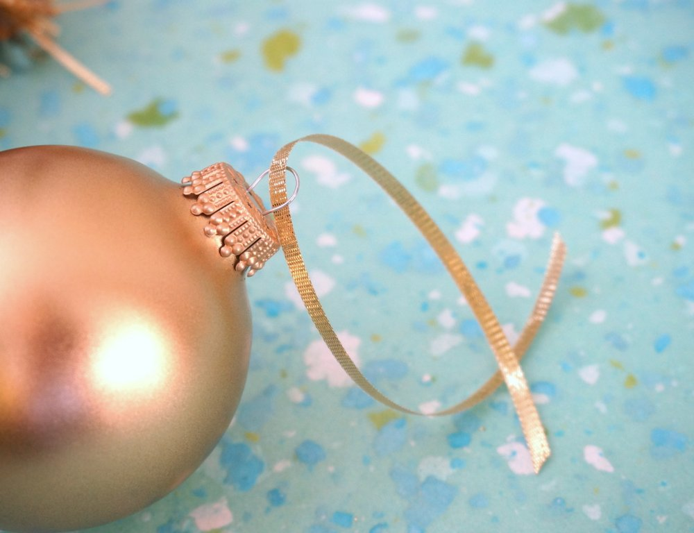 Gold ornament and ribbon