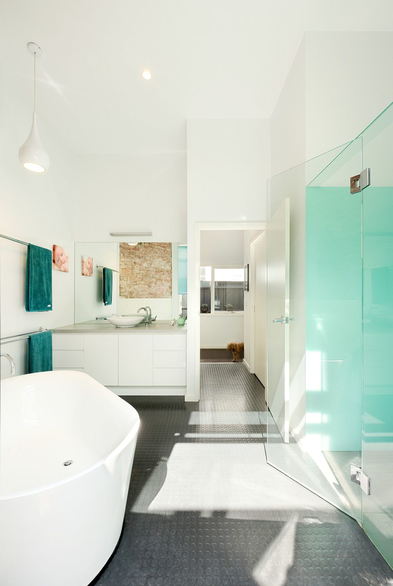 Gorgeous contemporary bathroom with non-slip floor and white walls