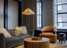 Gorgeous-use-of-carpet-and-floor-lamp-brings-a-dash-of-yellow-to-the-steely-industrial-loft-217x155