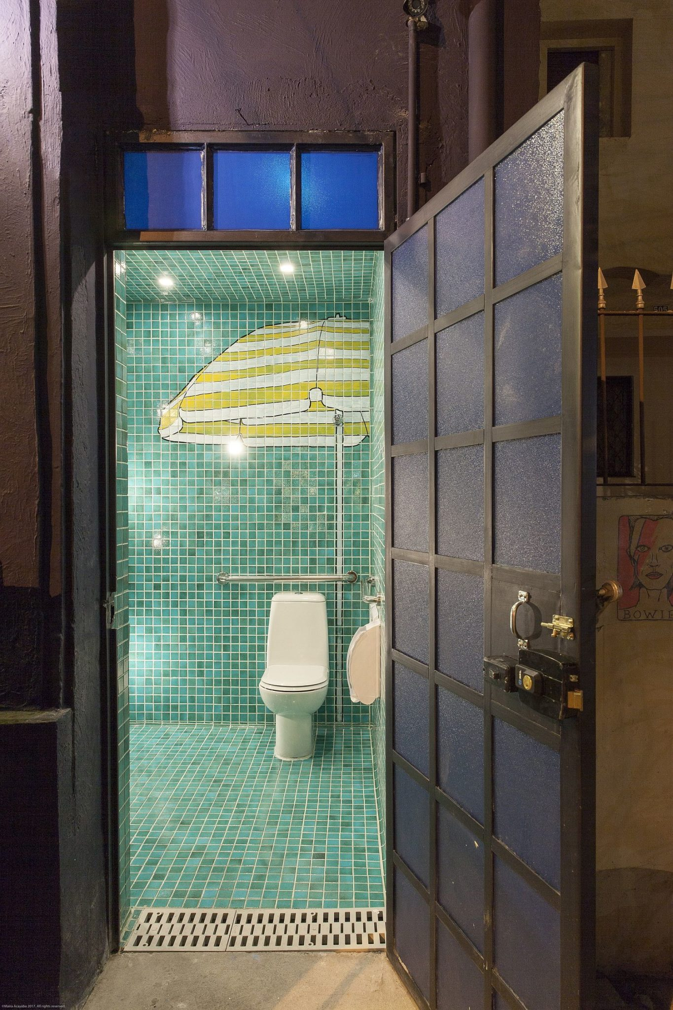 Green-tiled-restroom-of-the-Pizzeria