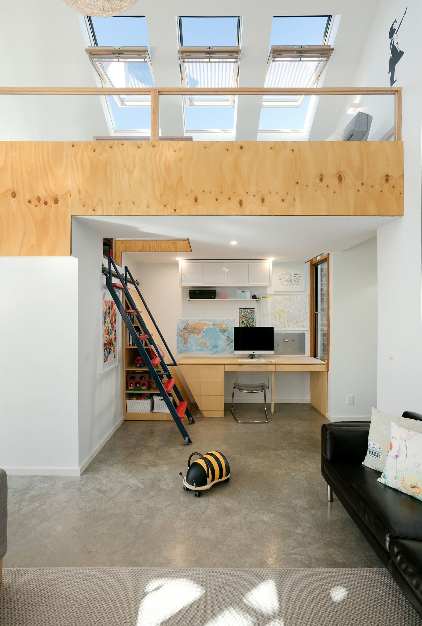 Home-work-space-under-the-mezzanine-level-with-a-simple-stairway