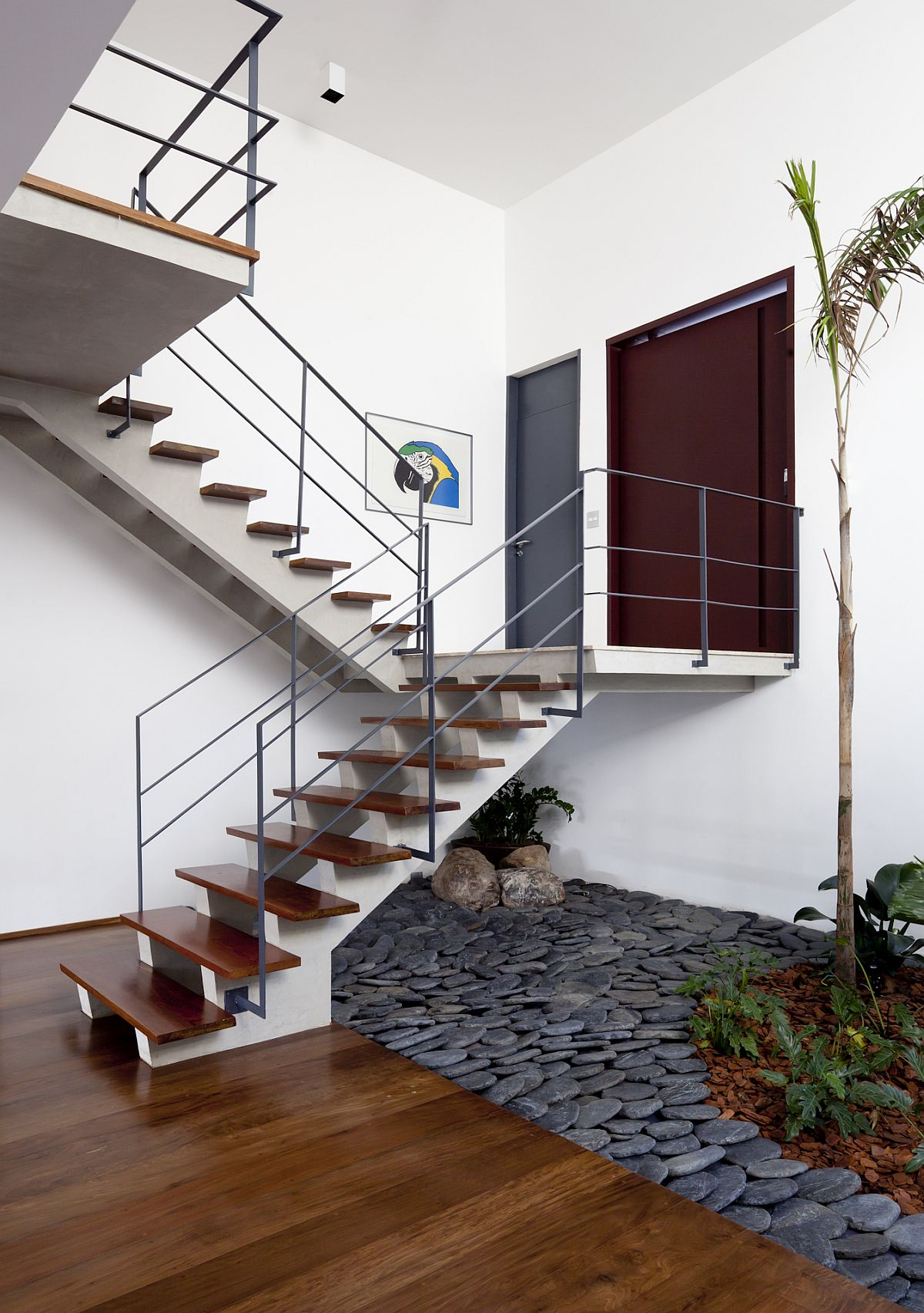 Indoor garden under the stairs with stones all around