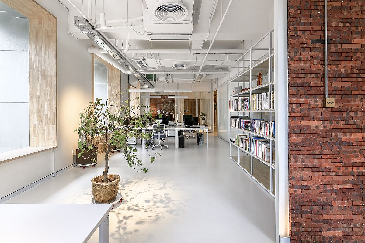 Exposed brick and natural greenery bring freshness to this for Office plants no natural light