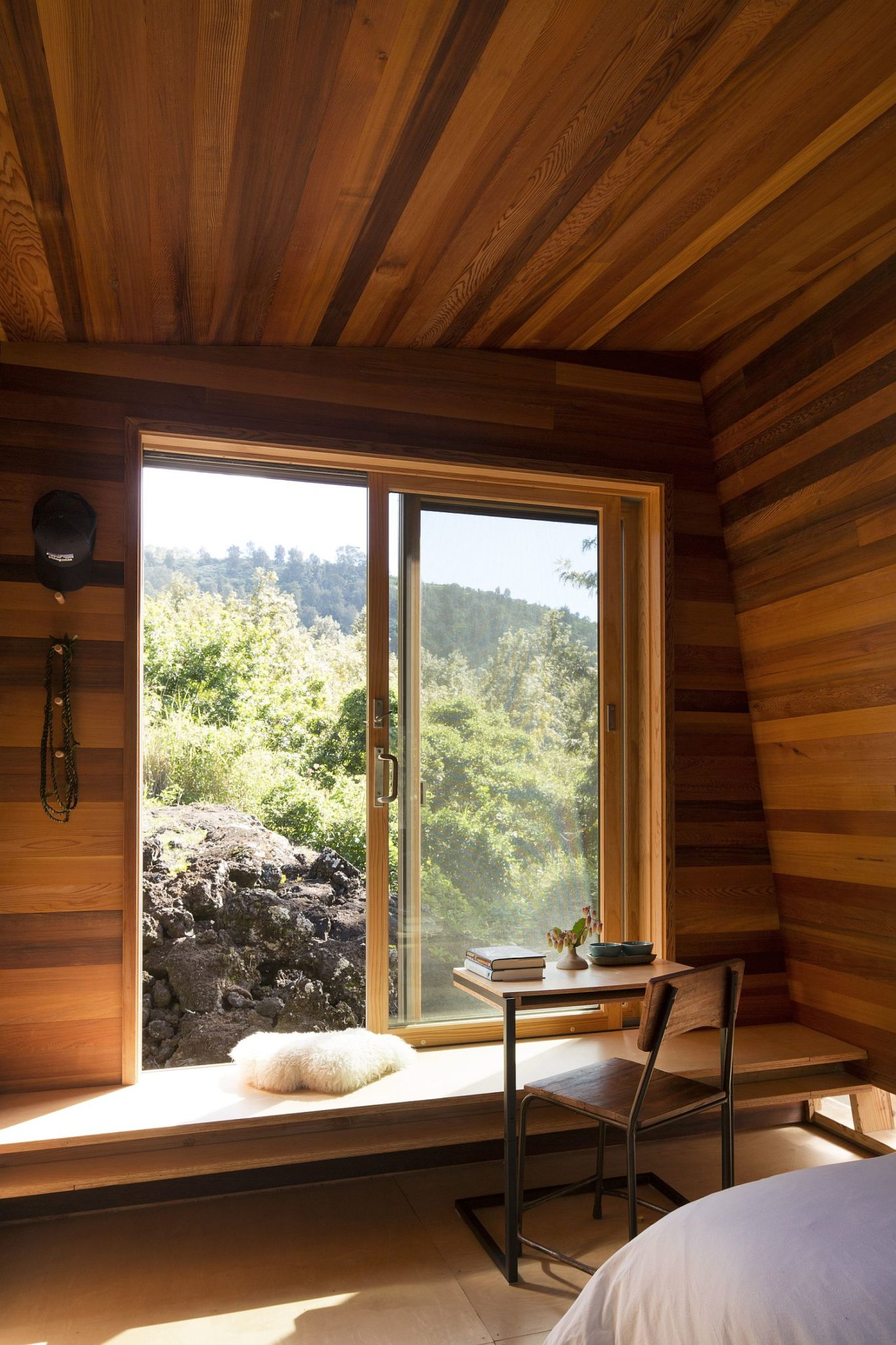 Large window of the bedroom offers wonderful views of the landscape outside