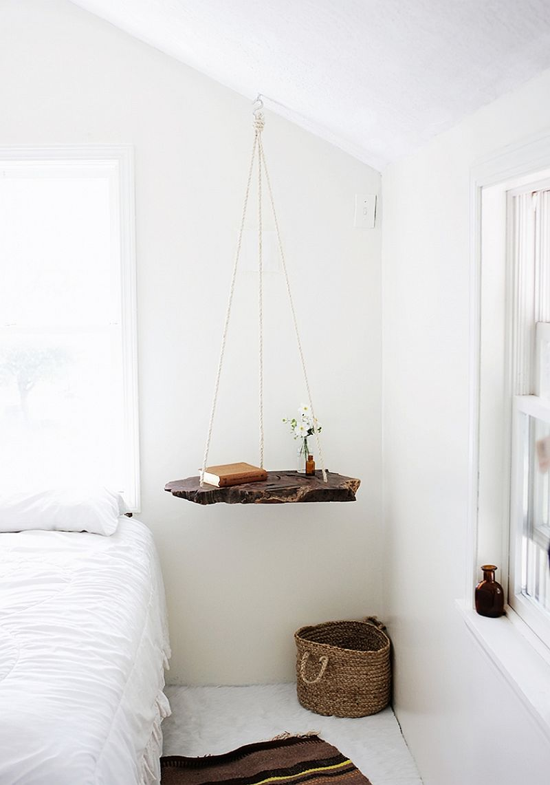 Live-edge hanging shelf used as a bedside table