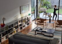 Living-room-of-the-Sao-Paulo-home-with-modern-couch-and-space-savvy-bookshelves-217x155