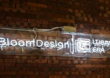 Logo-of-Bloom-Design-Studio-shines-bright-against-the-brick-wall-backdrop-217x155