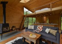 Lounge-and-loft-level-bedroom-of-the-cabin-in-woods-217x155