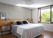 Low-ceiling-of-the-bedroom-gives-it-a-more-cozy-appeal-217x155