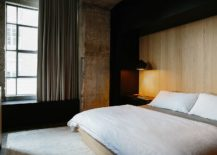 Minimal-industrial-bedroom-with-an-accent-wooden-wall-217x155